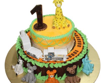 Jungle theme cake with running train